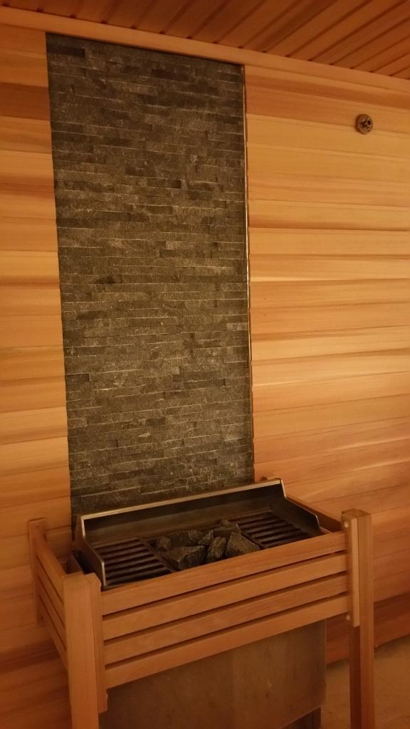 A coal grill inside a sauna room