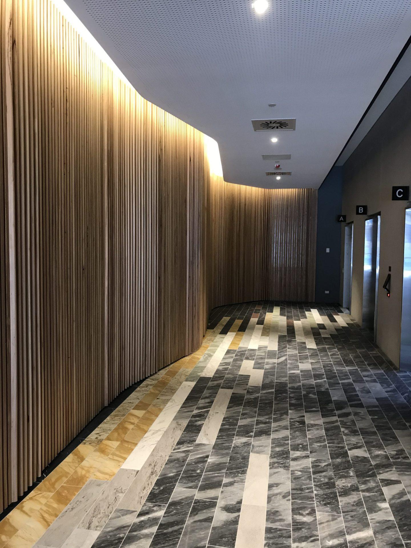 A tiled hallway inside a building