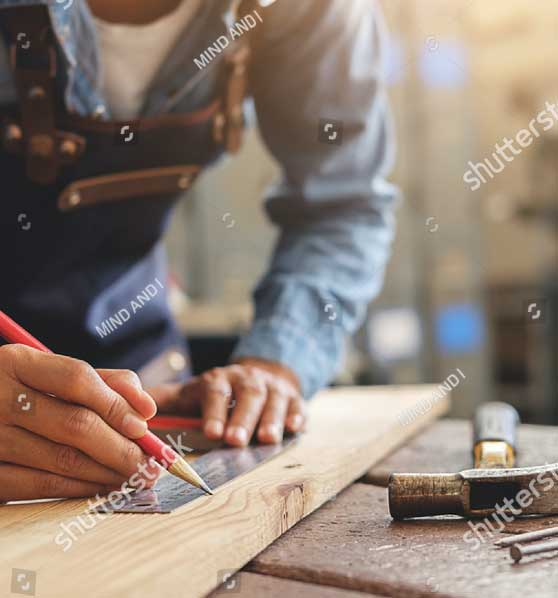 A woodworker measuring wood