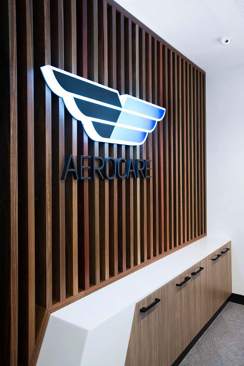 A company logo installed on the wall