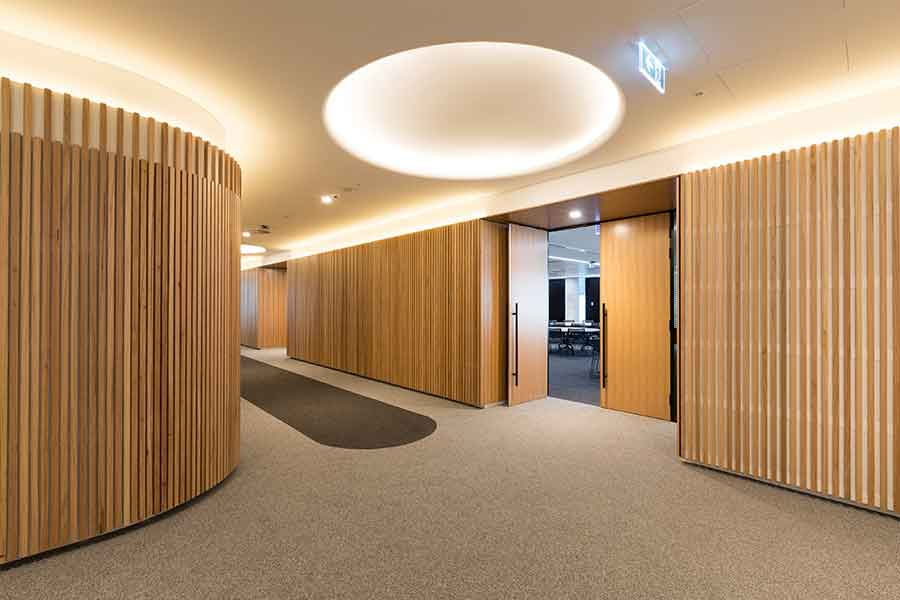 A carpeted office hallway